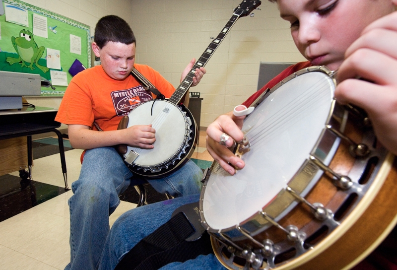 Cedar Ridge fifth grade. Coda Todd (left) and Colby Luckado pratice banjo.