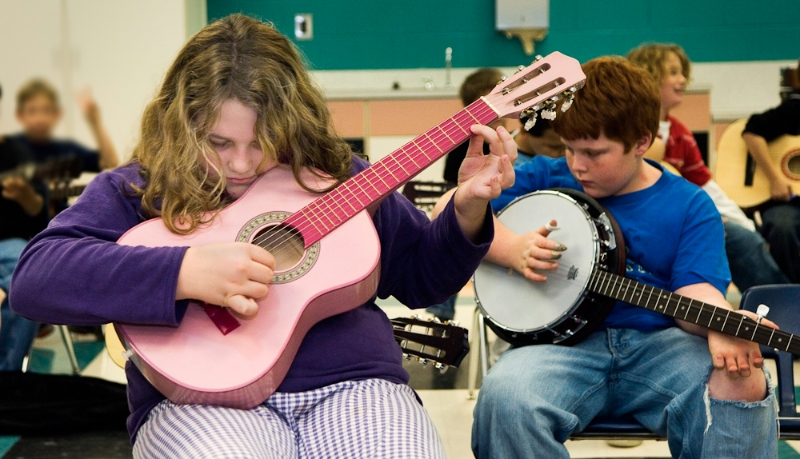 Fourth grade Cedar Ridge. Ashana Griffith (pink guitar) and Tanner Lowe, banjo.